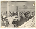 Athenaeum Ladies Auxiliary Dining with Harp Player, ca. 1945.