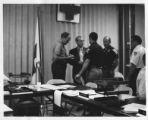 Men talking behind desks
