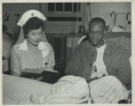 Gray Lady reading to patient