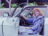 500 Festival Queen poses for seat belt safety, 1987