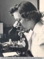 Riley Technician at Microscope, 1949.