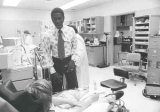 Rodney Shepard with dialysis patient, 1976.