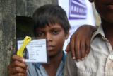 Boy shows his registration card for the camera