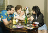 Two men and woman flirting and drinking