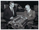 A.J. Scussel and Joe Miller Examining Vehicle Parts