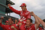 Junqueira Hoiseted on Crew's Shoulders after Winning Indy 500 Pole, 2002